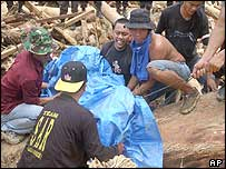 Search and rescue team recovering a body, Sumatra