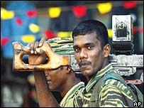A Tamil Tiger soldier arrives in Kilinochchi, Sri Lanka, ahead of celebrations to mark Martyr's Day