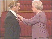 Beckham receives his OBE