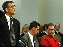 Prosecutor Jeffrey Baird stands in court with Gary Ridgway (seated right, in red shirt]