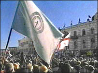 Flag over Georgian crowd