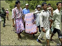 Villagers in Aceh carry the body of a dead Gam fighter
