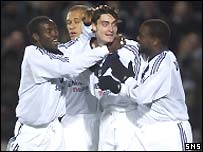 Albert Riera is congratulated by his team-mates after his goal