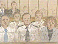 Court artist's sketch of Mr Huntley and Ms Carr in the dock with a policeman between them