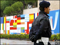 Italian policeman stands guard in Naples as EU FMs open talks
