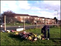 Flowers left where Johnny Delaney was killed