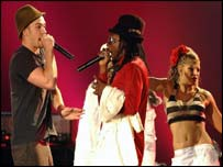 Justin Timberlake  (left) and The Black Eyed Peas perform live on stage
