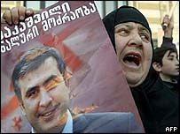 Woman with poster of opposition's Mikhail Saakashvili