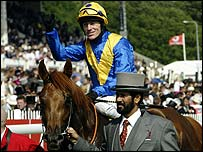 Kieren Fallon celebrates his 2003 Derby victory on Kris Kin