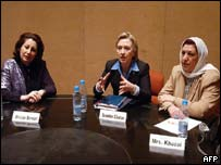 Hillary Clinton (C) talks during a meeting with Iraqi Minister of Public Works Nasrin Berwari (L) and Governing Council member Rajaa Khuzai.