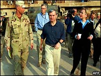 Jack Reed (middle) and Hillary Clinton with US troops