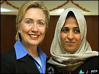 Hillary Clinton with an Iraqi civilian working for the US army in Baghdad