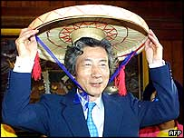Mr Koizumi tries on a traditional Vietnamese hat in Hanoi