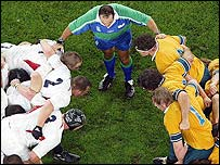 Referee Andre Watson oversees a scrum during the World Cup final