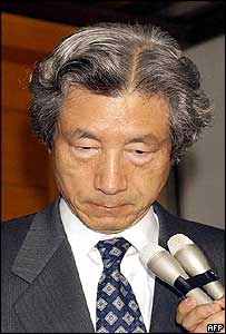 Japanese Prime Minister Junichiro Koizumi reacts to news of the deaths