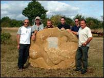 Engraved boulder and Birchgrove Group members at Stratton Wood