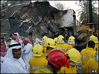 A bulldozer clears rubble from the blast scene