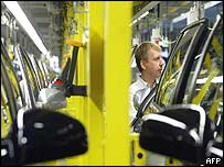 A worker building cars in an Poel factory in Germany