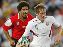 Wales skipper Colin Charvis chases down England centre Will Greenwood