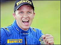 Petter Solberg celebrates his title-clinching win in Wales