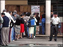 Voters line up outside a polling station in Guatemala