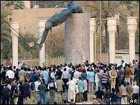 Iraqis surround toppled statue of Saddam Hussein, 9 April, 2003