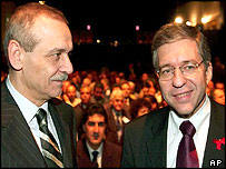 Former Palestinian minister and delegation chief Yasser Abed Rabbo, left, with ex-Israeli Justice Minister and Israeli delegation chief Yossi Beilin