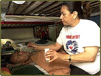 A hospice worker gives an Aids patient his medicine in San Jose, Costa Rica
