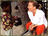 Emma Thompson, British actor and Aids activist with child in Mozambique