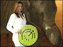 Rachael Taplin posing by a model elephant