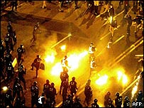 South Korean labour activists hurl firebombs at riot police during a rally turned violent in downtown Seoul,