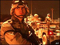 A US Army soldier of the 1st Armoured Division patrols the centre of Baghdad