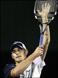 Andy Roddick celebrates victory over Carlos Moya