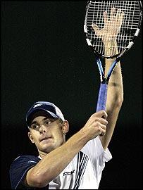 Andy Roddick celebrates victory over Carlos Moya