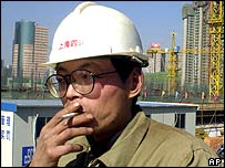 A construction worker takes a cigarette break in Shanghai