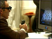 Gary Kasparov, wearing 3D glasses, uses a joystick to control the board, 11 November 2003