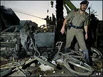 A Saudi policeman walks over the wreckage of the Riyadh bomb, 9 November 2003
