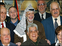 Yasser Arafat [centre] poses with Palestinian ministers in Ramallah