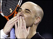 Andre Agassi celebrates a superb victory against Juan Carlos Ferrero
