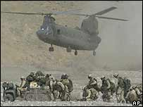 A US Chinook CH-47 helicopter lands to pick up troops in Afghanistan