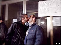 Jerome Castellano (L) and Manthos Peponas kiss at the protest