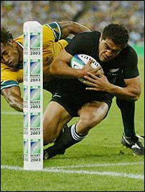 Mils Muliaina is tackled by Australia's Lote Tuqiri