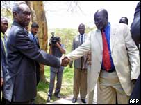 Sudanese Vice-President Ali Osman Taha with John Garang at peace talks in Kenya in September 2003