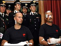 Wounded Italians giving news conference