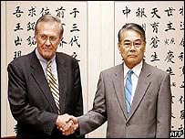 US Defence Secretary Donald Rumsfeld with Okinawa Governor Keiishi Inamine