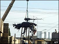 Crane lifts remains of Black Hawk in Mosul