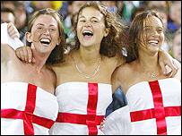 A trio of England fans get into the spirit