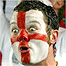 An England fan cheers on his side in the semi-final against France