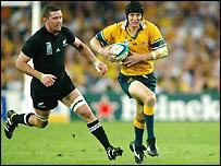New Zealand's Reuben Thorne tries in vain to catch Stephen Larkham