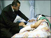 Turkish Prime Minister Recep Tayyip Erdogan visit a victim